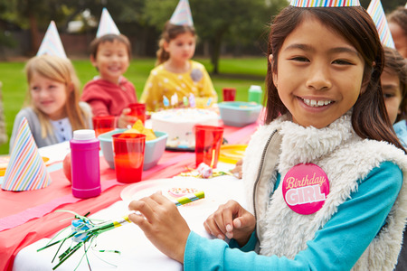 asian american: Group Of Children Having Outdoor Birthday Party