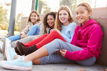 11: Four Young Girls Hanging Out Together In Park