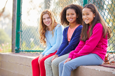 9 10 years: Three Young Girls Hanging Out Together In Park Stock Photo