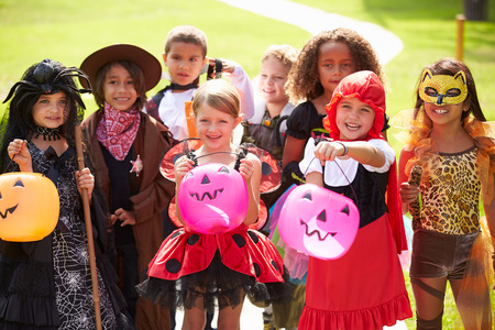 trick or treating: Children In Fancy Costume Dress Going Trick Or Treating