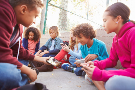 handphone: Group Of Young Children Hanging Out In Playground