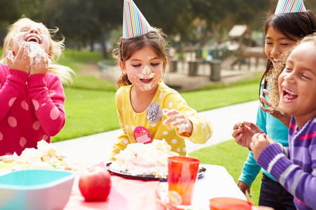 party table: Group Of Girls Having Outdoor Birthday Party
