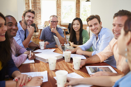 casual caucasian: Group Of Office Workers Meeting To Discuss Ideas Stock Photo