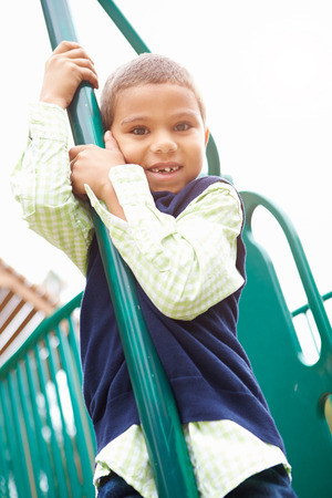 climbing frame: Young Boy On Climbing Frame In Playground