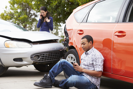 Male Driver Making Phone Call After Traffic Accident Stock Photo