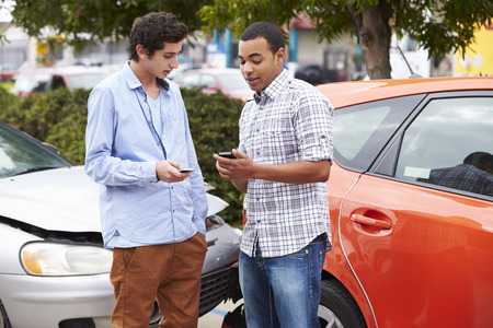 17 year old: Two Drivers Exchange Insurance Details After Accident