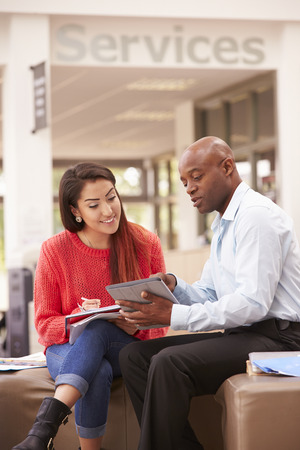 19 years old: College Student Having Meeting With Tutor To Discuss Work Stock Photo