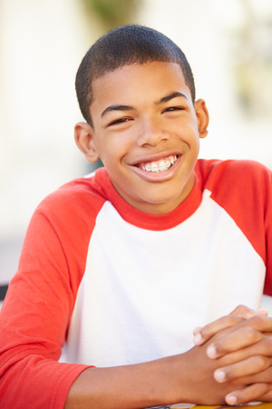 Portrait Of Smiling Teenage Boy