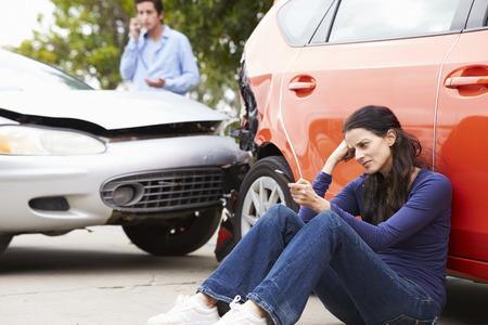 accident car: Female Driver Making Phone Call After Traffic Accident