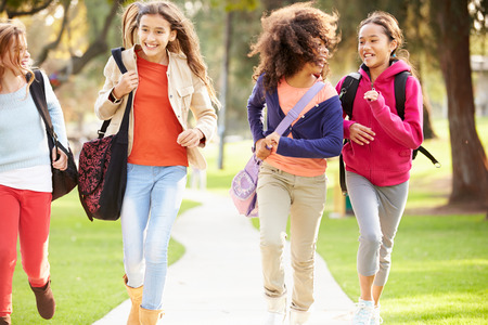 10 11 years: Group Of Young Girls Running Towards Camera In Park