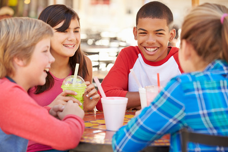 12 13: Group Of Children Hanging Out Together In Caf� Stock Photo