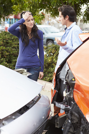 auto accident: Two Drivers Inspecting Damage After Traffic Accident