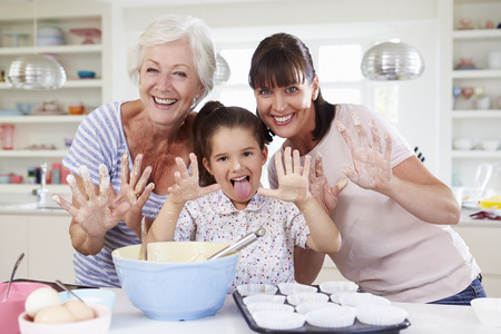 6 years: Grandmother, Granddaughter And Mother Baking Cake In Kitchen