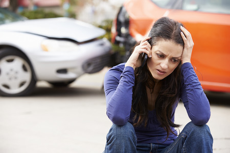 Female Driver Making Phone Call After Traffic Accident Reklamní fotografie - 42309327
