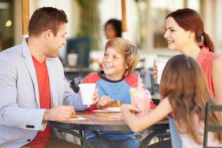 caf: Family Enjoying Snack In Caf� Stock Photo