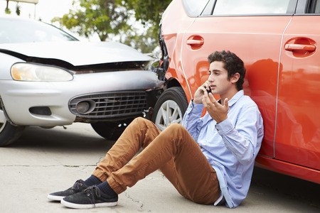 accident traffic accident: Teenage Driver Making Phone Call After Traffic Accident