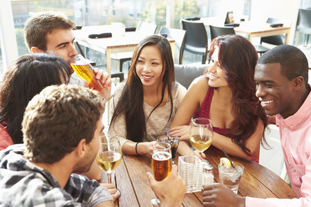 rooftop: Group Of Friends Enjoying Drink At Outdoor Rooftop Bar