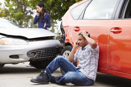 Male Driver Making Phone Call After Traffic Accident Foto de archivo