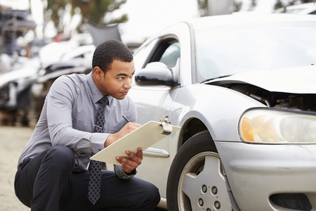 accident car: Loss Adjuster Inspecting Car Involved In Accident Stock Photo