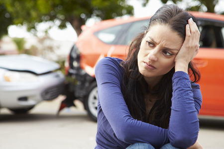 car wreck: Worried Female Driver Sitting By Car After Traffic Accident