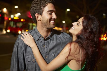 Couple Enjoying Night Out Together Stock Photo