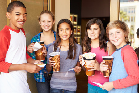 12 13: Group Of Children Standing Outside Cinema Together Stock Photo