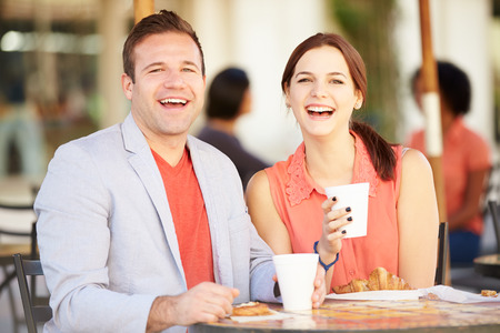 caf: Couple Enjoying Snack In Caf� Stock Photo