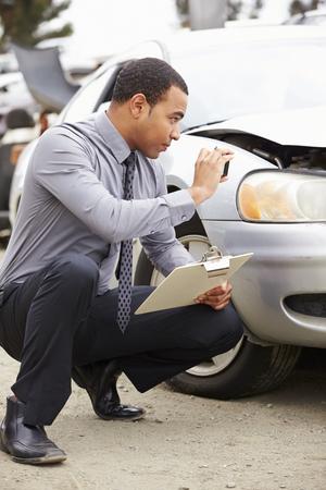 adjuster: Loss Adjuster Taking Photograph Of Damage To Car