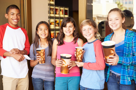 five years old: Group Of Children Standing Outside Cinema Together Stock Photo
