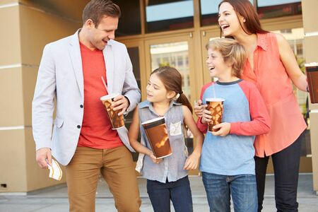 cinema people: Family Standing Outside Cinema Together Stock Photo