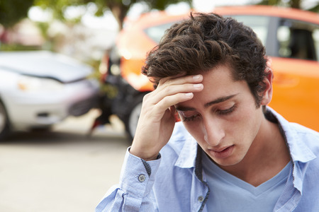 car wreck: Worried Teenage Driver Sitting By Car After Traffic Accident