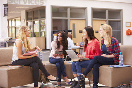 19 years old: Female College Students Sitting And Talking Together