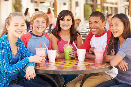black asian: Group Of Children Hanging Out Together In Caf� Stock Photo