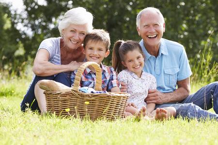 grandkids: Grandparents With Grandchildren Enjoying Picnic Together