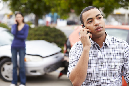 car wreck: Male Driver Making Phone Call After Traffic Accident Stock Photo