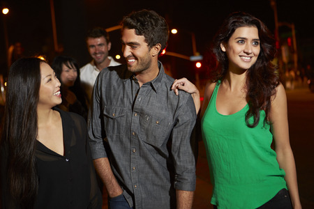 men women: Group Of Friends Enjoying Night Out Together