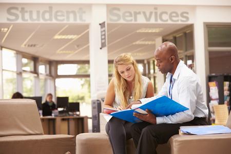 College Student Having Meeting With Tutor To Discuss Work 版權商用圖片