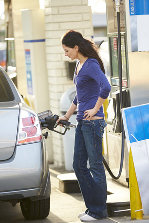 female driver: Female Driver Filling Car At Gas Station