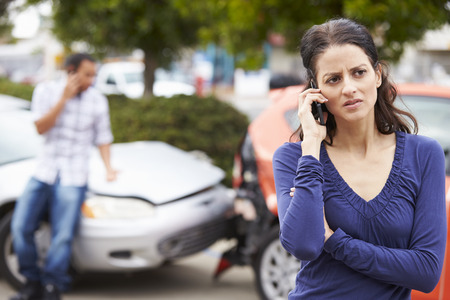 female driver: Female Driver Making Phone Call After Traffic Accident