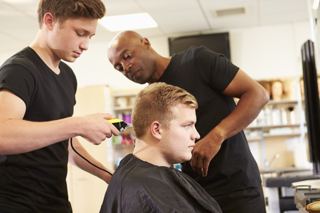 cutting hair: Teacher Helping Students Training To Become Hairdressers