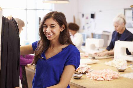 fashion design: Mature Students Studying Fashion And Design Stock Photo