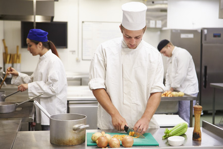 Students Training To Work In Catering Industry Stock Photo