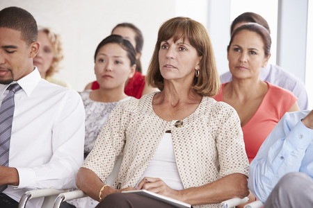 Business Delegates Listening To Presentation At Conference Stock fotó