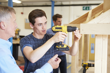 apprentice: Teacher Helping College Student Studying Carpentry