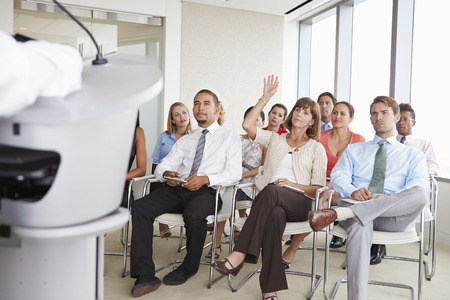 delegate: Delegate Asking Question At Business Conference Stock Photo