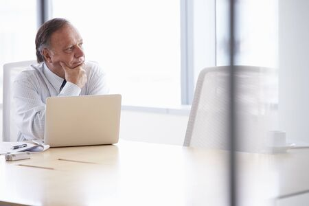 chairman: Senior Businessman Working On Laptop At Boardroom Table
