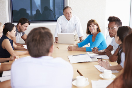native american man: Casually Dressed Businesspeople Having Meeting In Boardroom