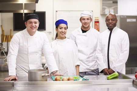 19 years old: Portrait Of Teacher With Students In College Catering Class