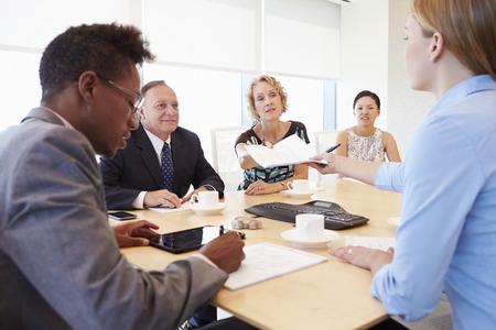 business people meeting: Five Businesspeople Having Meeting In Boardroom