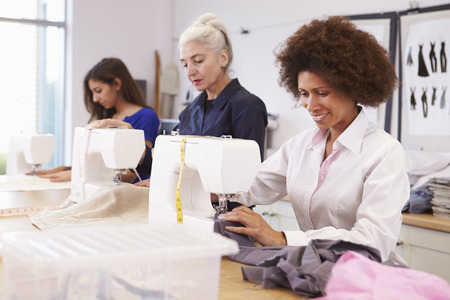Mature Students Studying Fashion And Design Standard-Bild